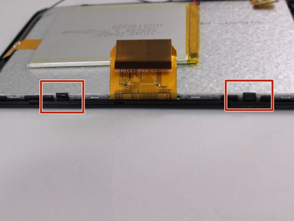 Image 1/3: Use one of the plastic opening tools next to one of the black clips on the side of silver screen.