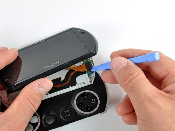 Use a plastic opening tool to disconnect the display cable from the rest of the device.