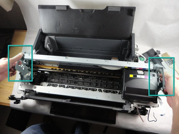 Remove printer mechanism from lower housing by holding the handles and lifting it upwards.