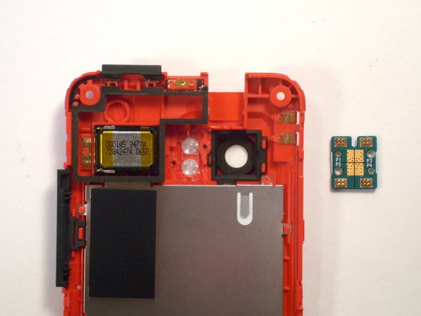 Image 2/2: Remove the dual LED flash board from the rear inner frame.