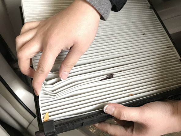 Push the air filter in the four corners to release the old one.