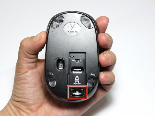 Hold the mouse so your palm is beneath, but not directly contacting, the top-side of the mouse.