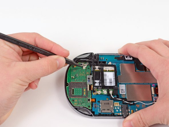 Using the pointy end of a spudger, gently pry the 3G antenna cable off the right button board.