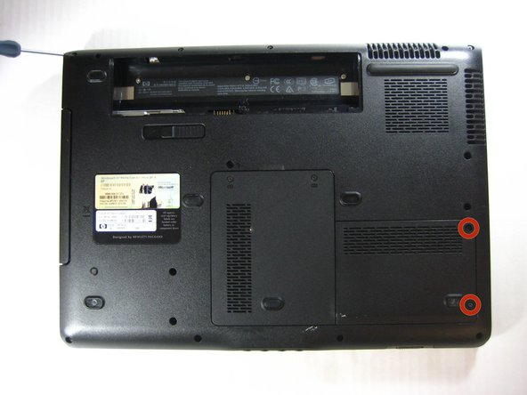 Loosen the two captive screws on the right hand side of the hard drive cover. The screws will remain attached to the cover.