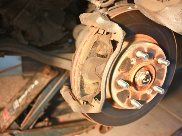 Do not let the caliper hang freely because the brake lines may stretch and weaken.
