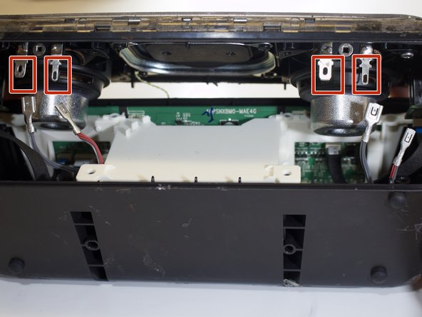 Unclip the four wire connectors (that are attached to the speaker lid).