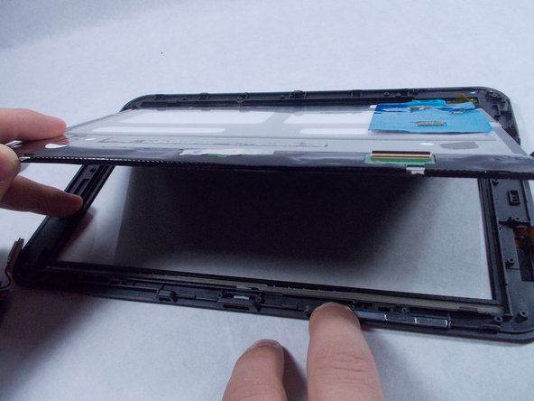 Carefully lift the internal components from the screen and place them into a replacement screen.
