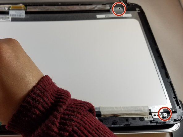 Remove the four 2.86 mm JIS#0 screws from each corner of the silver frame that is holding the digitizer.