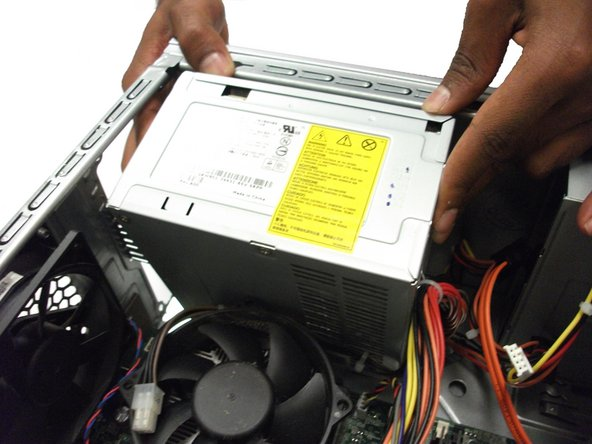 Gently remove the power supply from the case.
