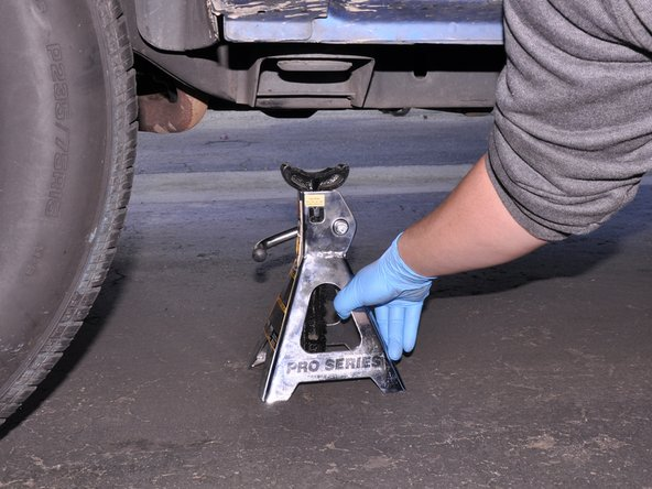 Slowly lower the truck and remove the jack.