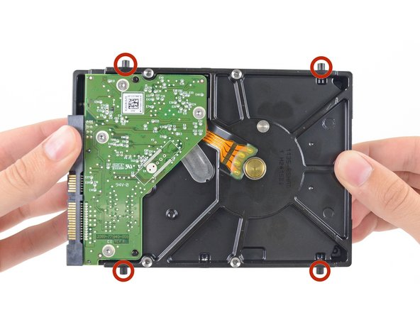 Remove the four 8.1 mm T8 screw posts from the hard drive, and transfer them to the replacement drive enclosure.