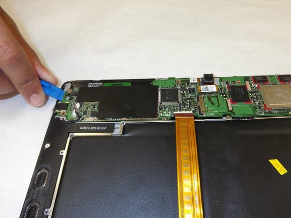 Use tweezers to remove red connecting wires. Remove the motherboard by lifting it upward.