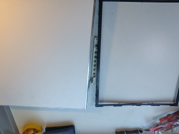 Image 2/2: Just like the previous frames, pop the plastic black frame apart from the rest of the monitor