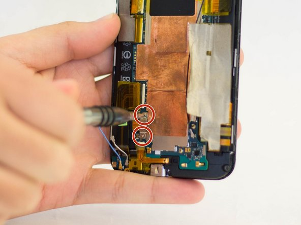 Remove the two 1.5 mm screws using a Phillips #00 screwdriver securing the battery connector to the motherboard.