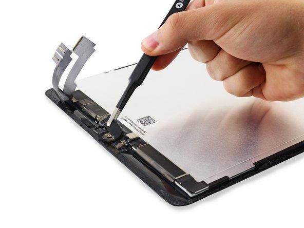 移走Home键支架,并剥去连接其的胶带。