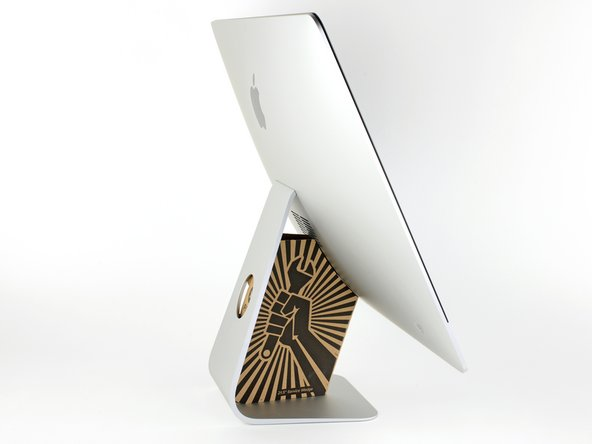 With the hinge free to move, the iMac will be unbalanced and hard to work on. Place an iMac service wedge, in the stand to stabilize the iMac.