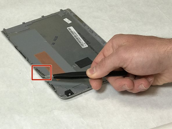 Using the tweezers remove the volume button located towards the top of the device, near the rear camera cut out.