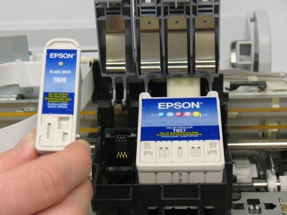 Remove the ink cartridge(s) that needs to be replaced. The black cartridge is on the left and the color cartridge is on the right.