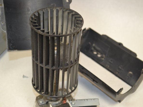 Put the new air filter casing in place after cleaning the filter.