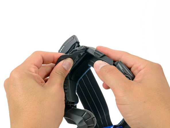 While firmly holding the keypad cover, pull the top of the strap mount cover up and off of the frame