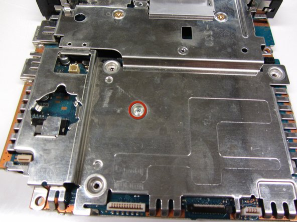 Locate the six 1.6mm screws that mount the metal plate to the motherboard.