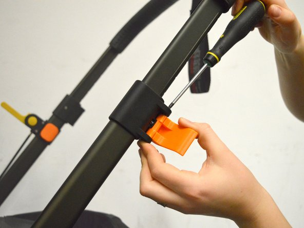 Hold it in place with one hand, while using the other hand to fasten the screw using the torx screwdriver.
