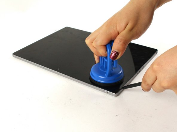 Use a suction cup to assist in lifting the screen while prying around its edges with a plastic spudger.