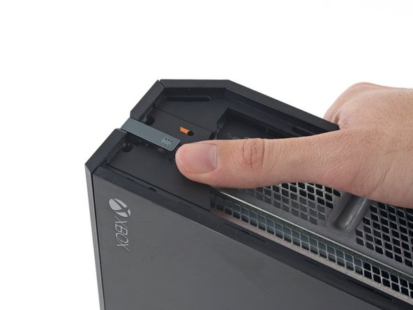 There is a small plastic tab that reinforces the front corner of the Xbox.