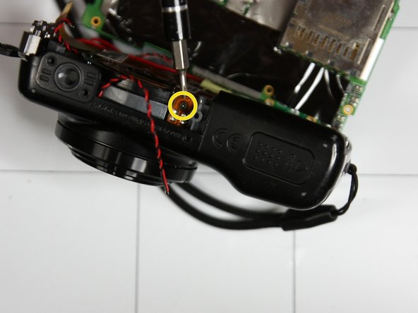 Remove screwed attached to orange circuit ribbon as shown in second picture.