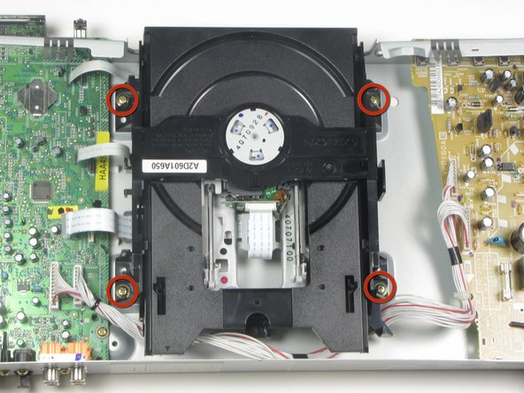 Remove the four screws holding the disc drive in place using a #0 Phillips screwdriver.