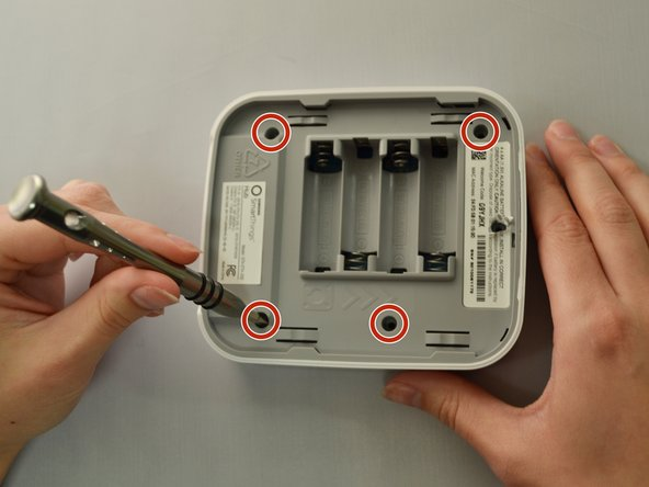 Using your Phillips #1 screwdriver, remove the four visible 12.5mm screws.