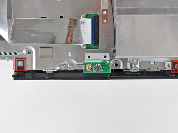 While lightly pulling the rear cover away from the logic board assembly, use the flat end of a spudger to release the clips along the top and bottom edges of the rear cover.