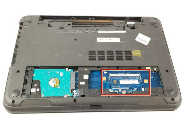Remove the memory card by pulling apart the latches holding it in place.