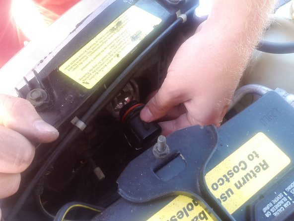 Image 1/1: Once the old bulb is removed, take your new one and place it in the headlight.