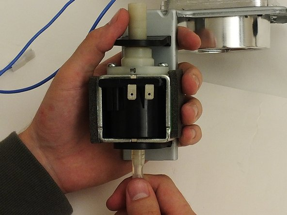 Image 2/2: Remove the filter attached to the bottom of the pump.