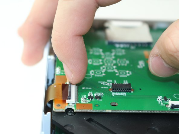 Lift the black latch on the ZIF connector and remove the ribbon cable that attaches the digitizer to the motherboard.