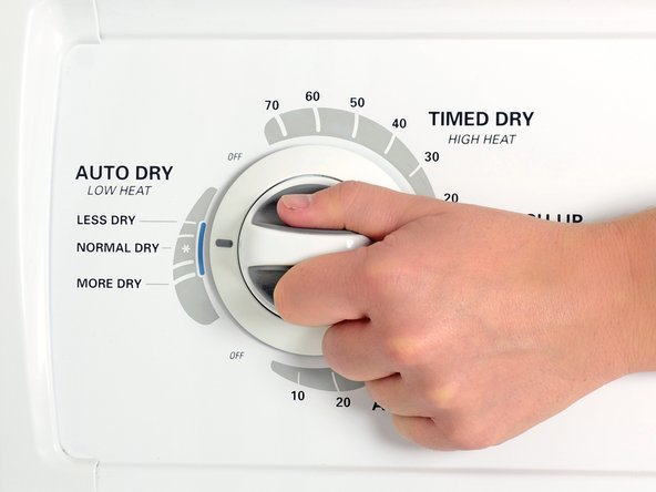 Set the dryer to a normal heat setting.