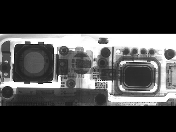 Another great improvement of the iPhone 6 platform is the camera. Here's the x-ray image of the top of the iPhone 6 showing both the FaceTime (right) and iSight (left) cameras. You can also see the flash LED has been beefed up quite a bit.