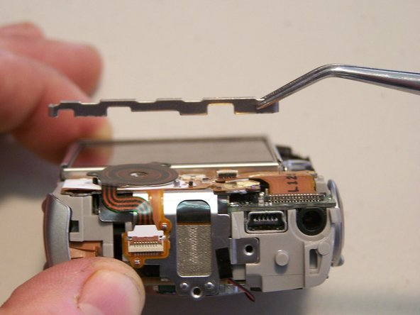 Image 1/2: Remove the three quarter bracket around the LCD screen.