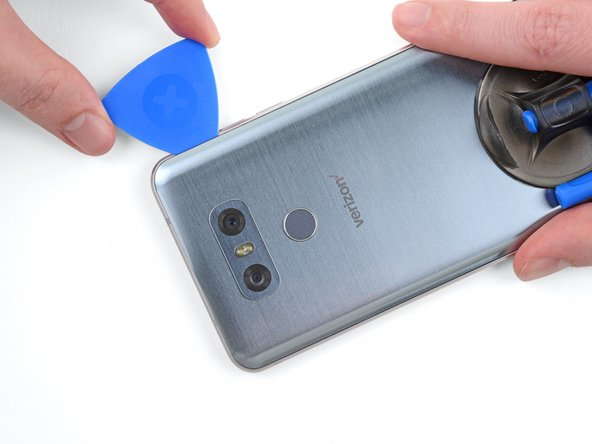 As seen in Step 1, the  fingerprint reader cable runs to the left of the camera, fairly close to the edge of the phone. Be careful as you cut through the adhesive in the upper edges of the phone.