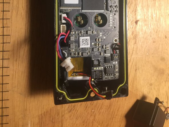 After the speaker has been removed, you should now be able to see the battery underneath.