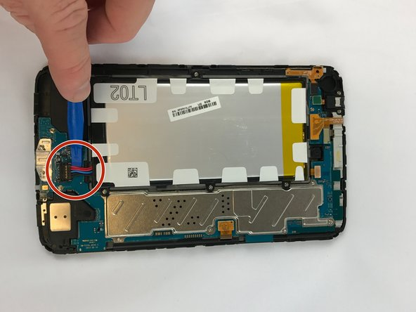 Unplug the battery connection carefully using the plastic opening tool.