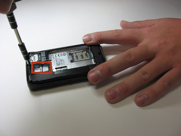 Now that we have taken everything off the back of the phone we will need to take a screw driver and take the six screw located on the back out of the phone. This will allow you to take apart the phone in two halves.