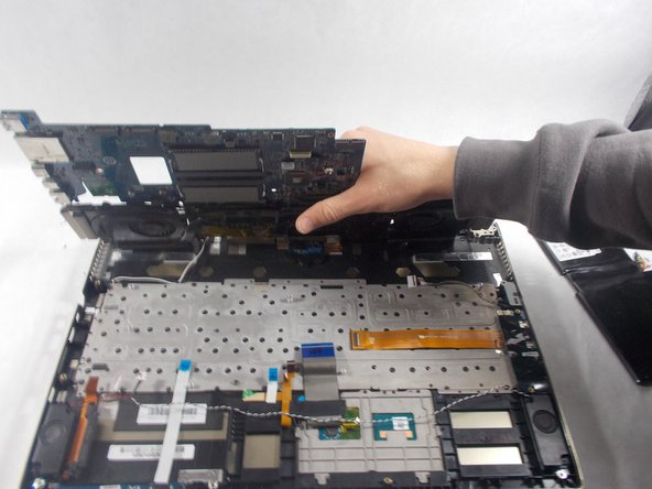 Lift the motherboard up and out of the device casing.