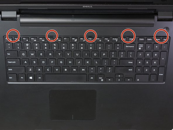 Locate the 5 keyboard tabs at the side of the keyboard closest to the screen.