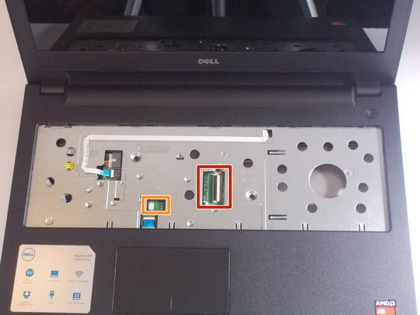 If your version of this laptop has a backlit keyboard, there will be two connectors; the one highlighted orange will also have to be removed.