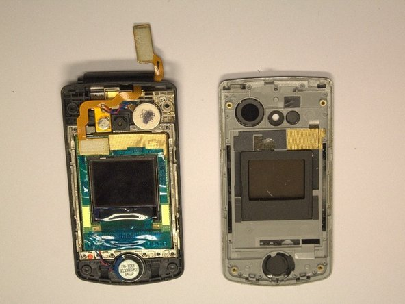 Once loose, the front cover should easily be pulled away from the phone, as shown in the second picture.