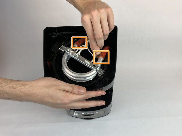 Pinch the tube clips and remove from tubes from the heating element.
