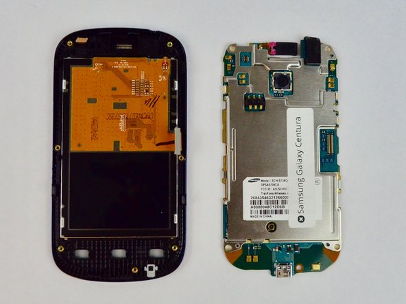Image 3/3: After releasing the clips, gently raise the motherboard, exposing the screen from the back.