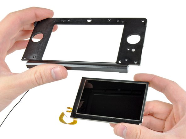 "Image 1/2: There's three cable connectors for this LCD -- to display the image, as well as for the [http://en.wikipedia.org/wiki/Parallax_barrier|parallax barrier] that gives the ""3D"" effect in the 3DS' games."
